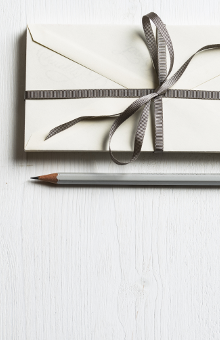 Letter envelope and pencil